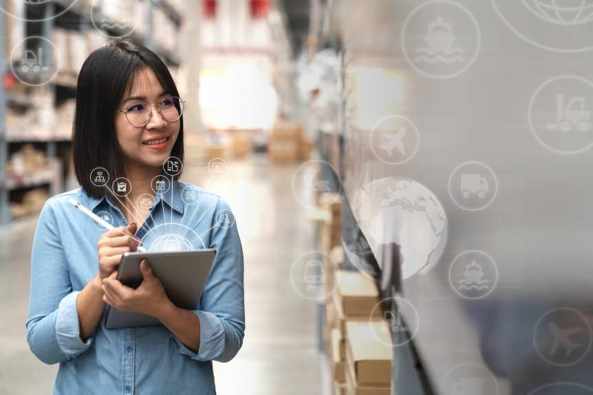Young attractive asian manager woman looking, picking, replemishment, receiving inventory at store warehouse in warehouse management system concept. Smart ERP with iot for inventory management. (Young attractive asian manager woman looking, picking, r